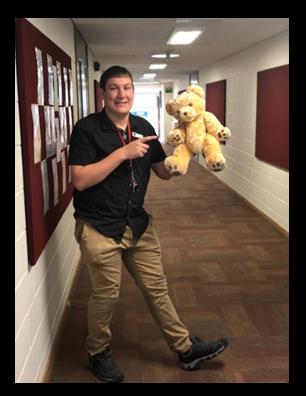 Teacher holding a teddy bear