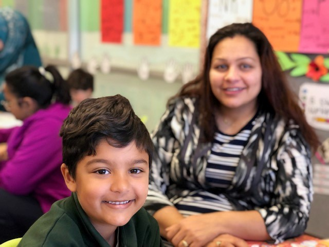 a photo of a child and his mum at a learning journey