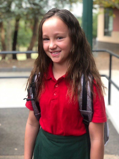 A photo of a year 4 girl in the playground
