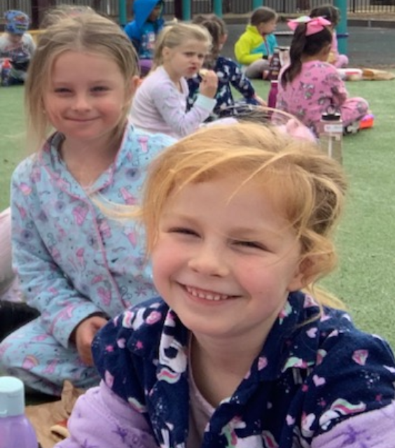 children having fun dressed in their pyjamas at school