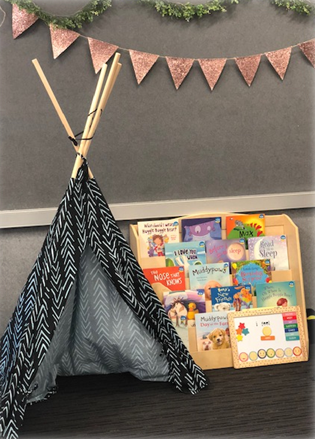 a tent set up in a classroom
