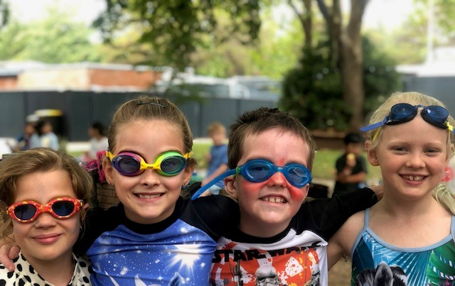 children having fun at the swimming carnival.