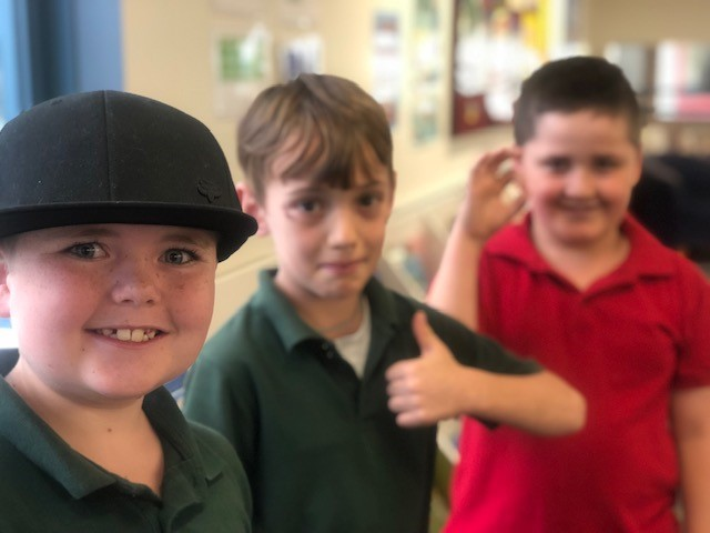 a photo of a boy in the library with friends