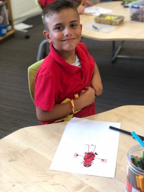 a photo of a year 2 boy writing