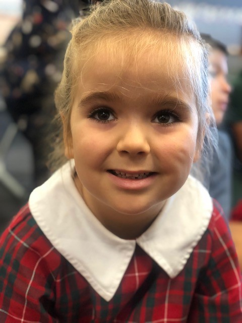 a photo of a child in assembly