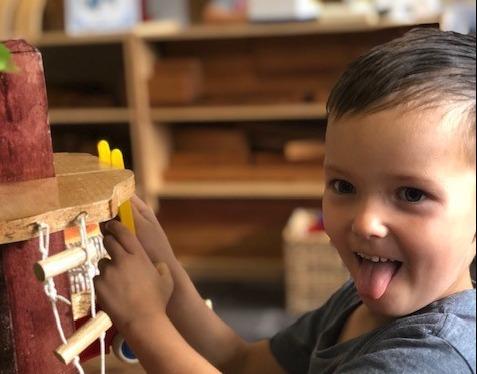A photo of preschool boy playing