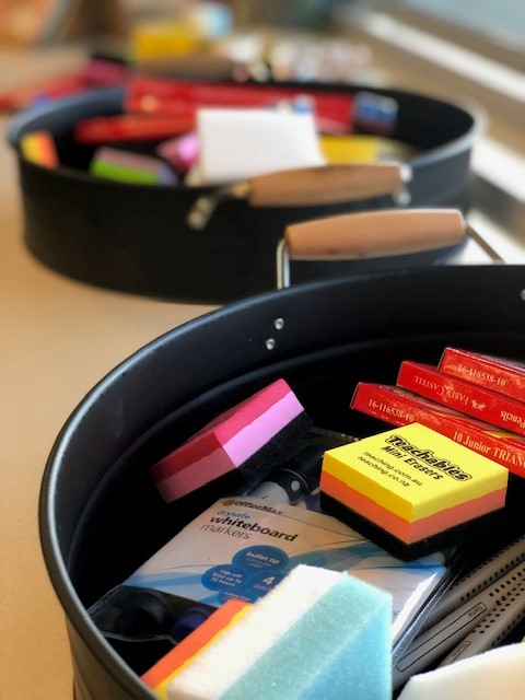 a photo of whiteboard erasers on a desk