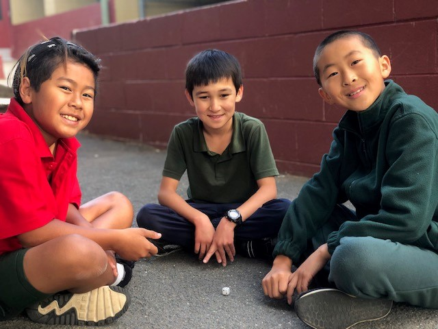 A photo of three children playing