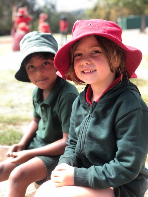 a photo of year 1 children playing in the playground