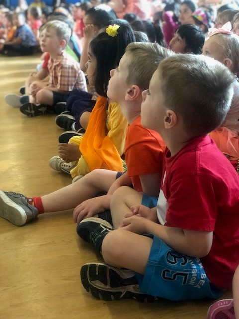 A photo of preschool children at an assembly