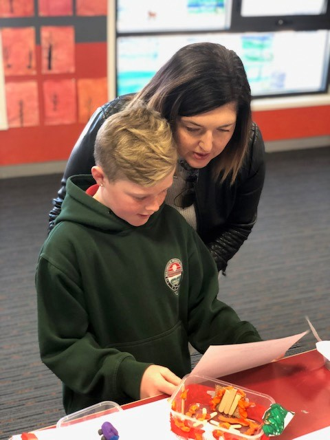 Child and parent sharing a learning journey