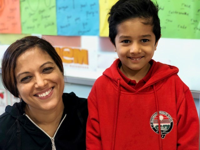 A child and his mother in kindergarten